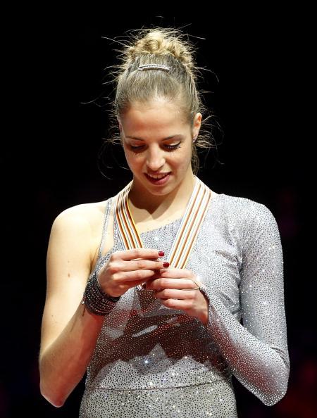 Italia Carolina Kostner poses with the m