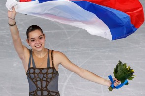 Russia's Adelina Sotnikova celebrates holding her flag at the end of the Figure Skating Women's free skating Program at the Sochi 2014 Winter Olympics